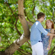 Young beautiful couple having fun in a park — Stock Photo #43485727