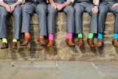 Colorful socks of groomsmen — Stock Photo