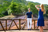 Young couple sightseeing Chamarel coloured earths — Stock Photo