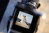 Shooting a wedding with a vintage camera — Stock Photo