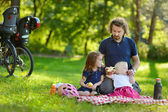Young father and his daughters having a picnic — Stock Photo