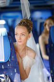 Beautiful young bride portrait in a bus — Stock Photo