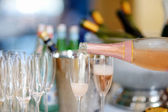 Pouring champagne into a glasses — Stock Photo