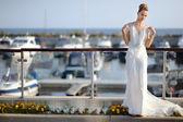 Beautiful bride posing in a harbor — Stock Photo