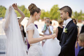 Happy bride and groom getting ready for a wedding — Stock Photo