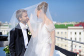 Outdoor portrait of bride and groom — Stock Photo