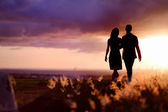 Young couple enjoying the sunset — Stock Photo