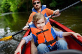 Little girl and her father on a kayak — Stock Photo