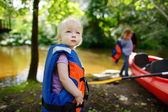 Cute toddler girl getting ready for kayaking — Foto Stock