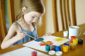 Cute little girl is drawing with paints — Stock Photo