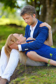 Young beautiful couple having fun in a park — Stock Photo