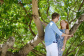 Young beautiful couple having fun in a park — Stockfoto