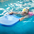 Happy little girl learning to swim — Stock Photo #44808485
