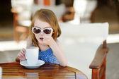 Girl drinking hot chocolate — Stock Photo