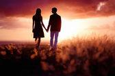 Young couple enjoying the sunset — Stock Photo