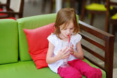 Girl drinking milkshake — Stock Photo