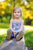 Adorable little girl outdoors — Stock Photo