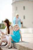 Adorable little girl eating ice cream — Stok fotoğraf