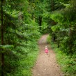 Little girl walking all alone — Stock Photo