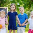 Four little kids by chalkboard — Stock Photo #49277005