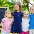 Four little kids by chalkboard — Stock Photo #49277037
