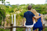 Young couple  on Chamarel falls — Stock Photo