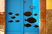 Fish on blue door — Stock Photo