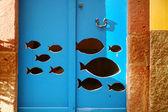 Fish on blue door — Foto de Stock