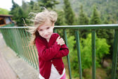Little girl on    windy day — Stock Photo