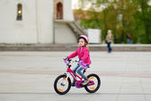 Little girl riding   bike — Stock Photo