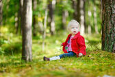 Girl sitting in forest — Stock Photo