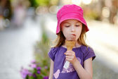 Girl eating ice-cream — Stock Photo