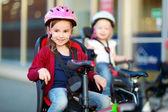 Little sisters on   bike — Foto Stock