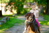 Little girl riding   pony — Stock Photo
