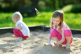 Two little sisters playing — Stock Photo