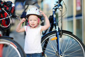 Little  girl ready to ride   bike — Stock Photo