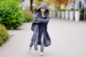 Girl wearing her father's coat — Foto de Stock