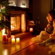 Mother and daughters near fireplace — Stock Photo #49612239