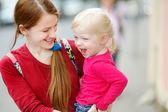 Mother holding her  girl — Stock Photo