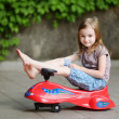Girl driving toy car — Stock Photo #50226663