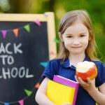 Excited little schoolgirl — Stock Photo #50226699