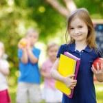 Little schoolgirl going back to school — Stock Photo #50227067