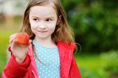 Little girl holding   strawberry — Stock Photo