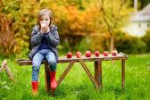 Little girl   on    bench — Stock Photo