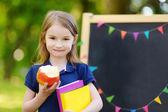 Excited little schoolgirl — Photo