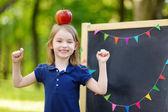 Excited little schoolgirl — Zdjęcie stockowe