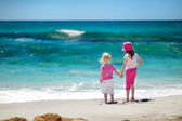Little sisters   on   beach — Stock Photo