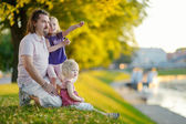 Father and daughters by river — Photo
