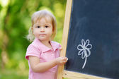 Adorable toddler drawing with chalk — Stock Photo
