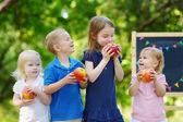 Four little kids by chalkboard — Foto de Stock